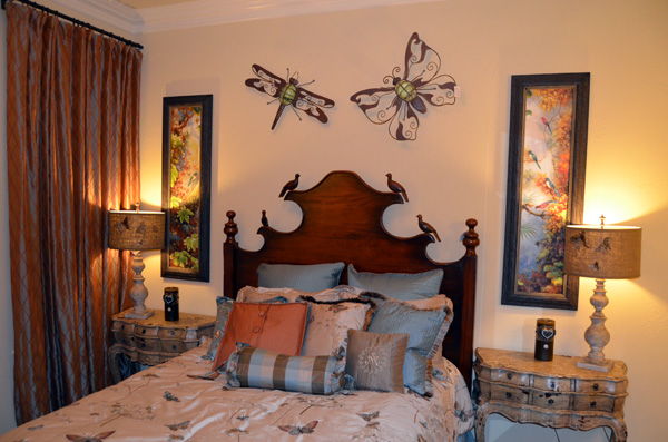 Guest bedroom adorned with birds and butterflies