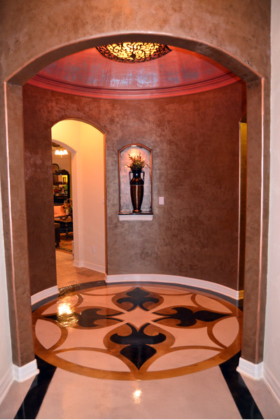 Parade of Homes Entrance Hall with beautiful  floor design and domed-ceiling